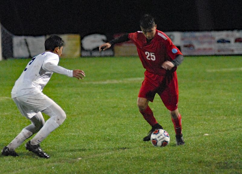 GRESHAM OUTLOOK: MATT RAWLINGS - Centennial's Andrew Martinez tries to get past his man in the Eagles first round playoff loss to Lake Oswego on Saturday night.