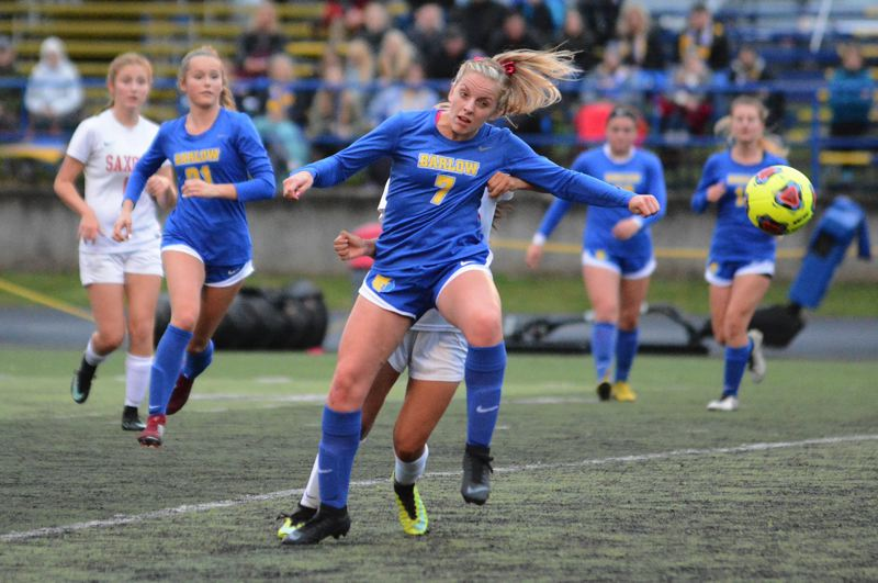 OUTLOOK PHOTO: DAVID BALL - Barlows Monica Gifford plays a ball into the attacking zone during Saturays 5-1 playoff win over South Salem.