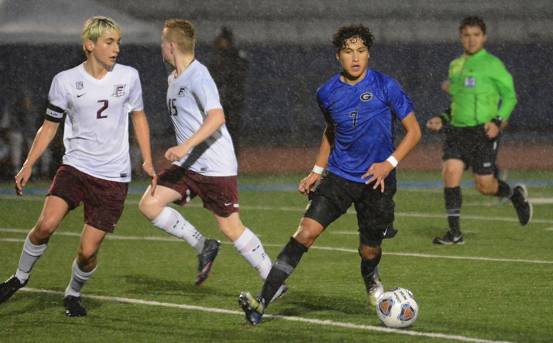 OUTLOOK PHOTO: DAVID BALL - Greshams Andrew Nunez runs down a ball near the sideline during the teams 3-1 playoff win over Franklin on Saturday.