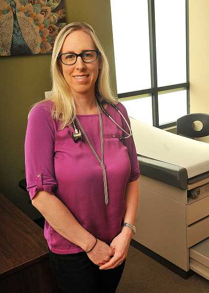SPOKESMAN PHOTO: VERN UYETAKE  - April Voves opened her private practice in Wilsonville Oct. 1 and operates out of West Chiropractic.