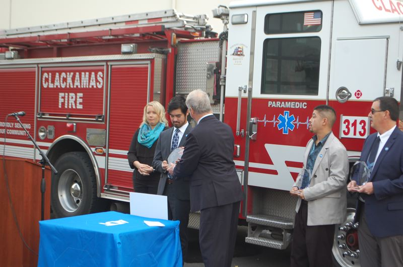 PHOTO BY: RAYMOND RENDLEMAN - Happy Valley resident Lisa Macias (left) at an award ceremony for Clackamas Fire and ADT.