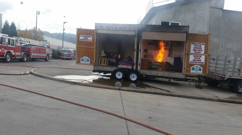 PHOTO BY: RAYMOND RENDLEMAN - A burn trailer demonstrates the difference sprinklers can make in reducing the speed a fire burns.