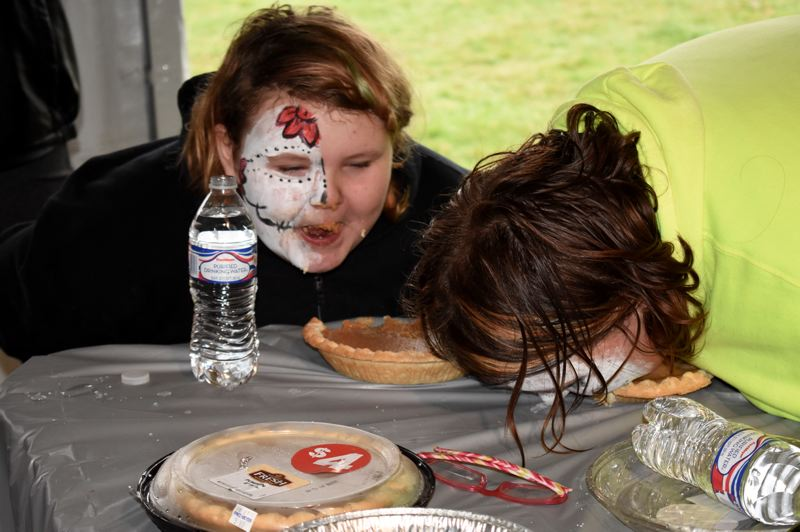 5/6: OUTLOOK PHOTO: CHRISTOPHER KEIZUR 7/8 OUTLOOK PHOTO: MATT DEBOW - Sisters Kelsey Davis, 10, and Sadie, 13 compete in a pie eating contest on Saturday, Oct. 27 at Wood Villages annual Great Pumpkin Festival. Sadie won the contest as she was the only participant to actually finish the entire dessert.