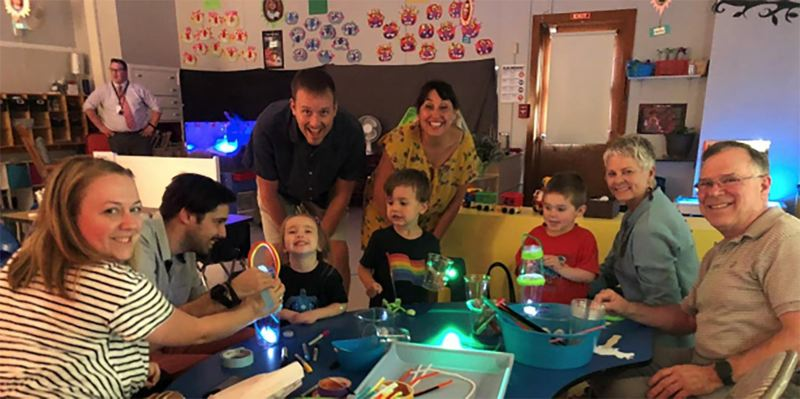 Parents help their preschoolers explore light and shadows during the annual science night event at Eastham Center in Oregon City.