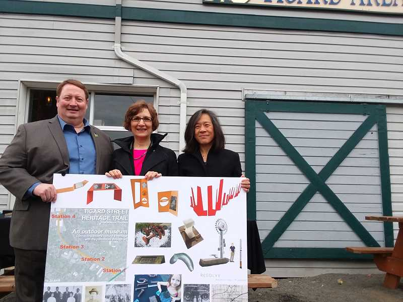 TIMES PHOTO: RAY PITZ - Tigard Mayor John Cook, left, U.S. Rep. Suzanne Bonamici and urban designer Suenn Ho, hold up a poster board filled with plans to create a Tigard Outdoor Museum along the Tigard Street Heritage Trail during a presentation for officials on Thursday.