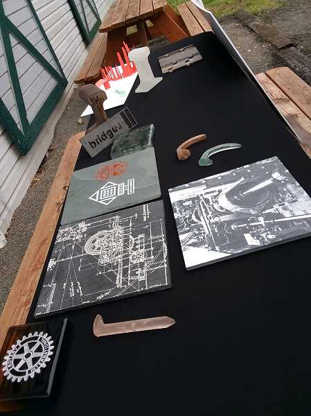 TIMES PHOTO: RAY PITZ - Here are some of the artifacts/replicas that are likely to be included in the Tigard Outdoor Musuem located next to Symposium Coffee on Main Street.