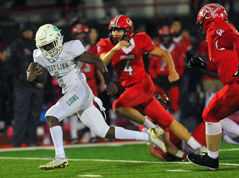 TIDINGS PHOTO: VERN UYETAKE - West Linn senior running back Dawson Jolley breaks free for some of his 231 rushing yards during his team's 46-14 win at Oregon City on Friday.