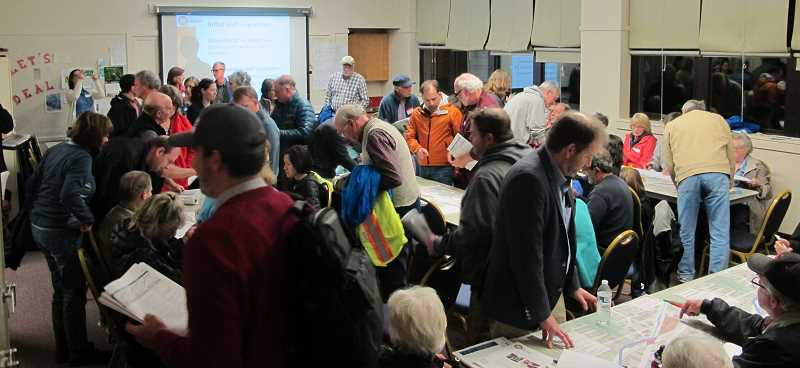 PHOTOS BY BILL GALLAGHER - Dozens of residents interested in plans for a possible SW Light Rail line packed a meeting room at the Multnomash Arts Center.