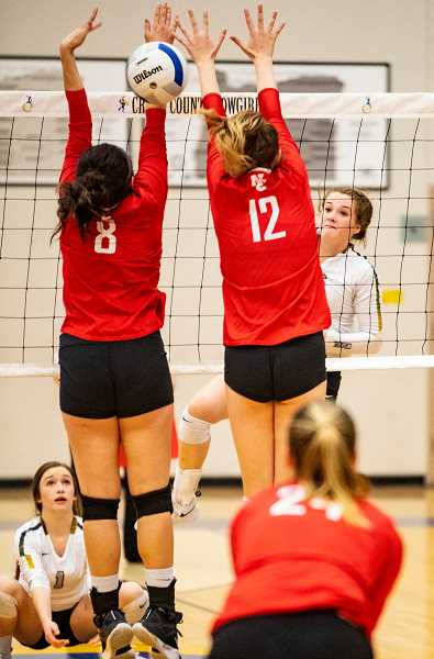 LON AUSTIN/CENTRAL OREGONIAN - Raegan Wilkins blasts one of her 26 kills in the Cowgirls' victory over the Highlanders, while Stormie Camara covers. Wilkins earned her 26 kills in 85 attempts.