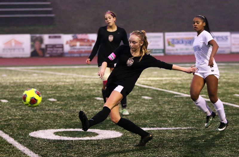 TIMES PHOTO: DAN BROOD - Tualatin High School junior defender Aiden Lynch, after battling a bloody nose, boots the ball up field during the Timberwolves 1-0 win over South Medford on Saturday.