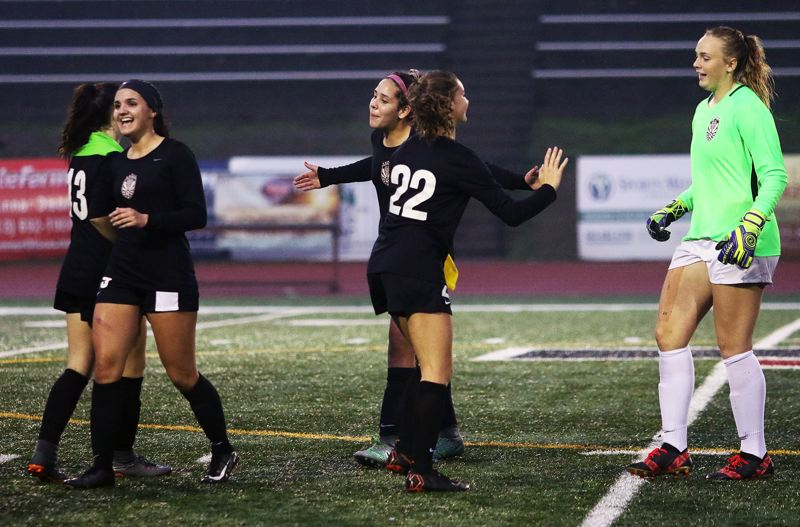 TIMES PHOTO: DAN BROOD - Tualatin players (from left) Alyvia Embree, Felicity Ganzar, Skylar Maddox, Brook Burke and Sarah Hall are all smiles following the 1-0 state playoff win over South Medford.