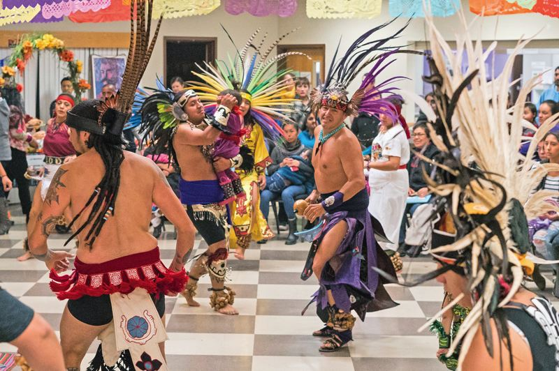 FILE PHOTO - Aztec dance group Titlakawan perform at Centro Cultural de Washington County's Dia de los Muertos event in 2016.