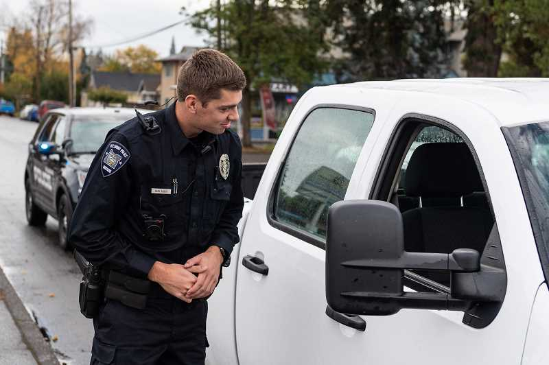 STAFF PHOTO: CHRISTOPHER OERTELL - Hillsboro Police officer Matt Delepine wears his Axon body-worn camera at the Hillsboro Police Department during a traffic stop on Friday, Oct. 26.