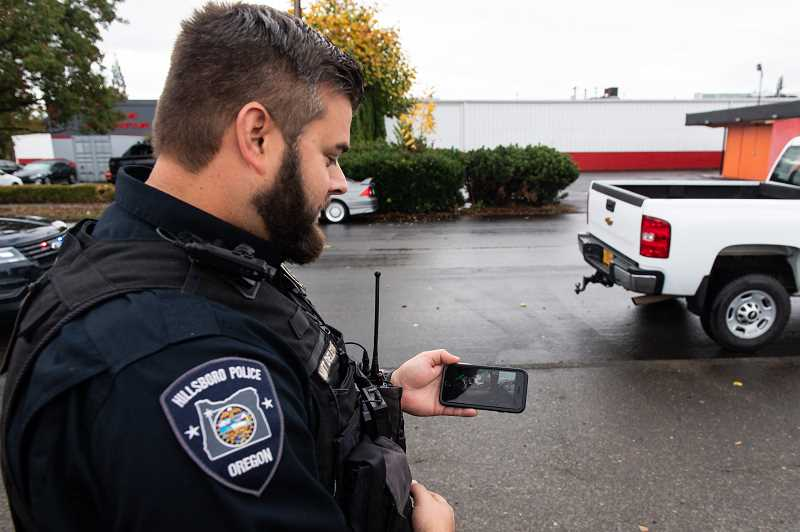 STAFF PHOTO: CHRISTOPHER OERTELL - The new Axon-brand body-worn cameras used by the Hillsboro Police Department immediately send footage to a city server for storage and can be viewed on the officer's phone. Police can turn the cameras on manually during interactions with the public and automatically turn on when an officers police car lights are activated or the Taser is turned on.