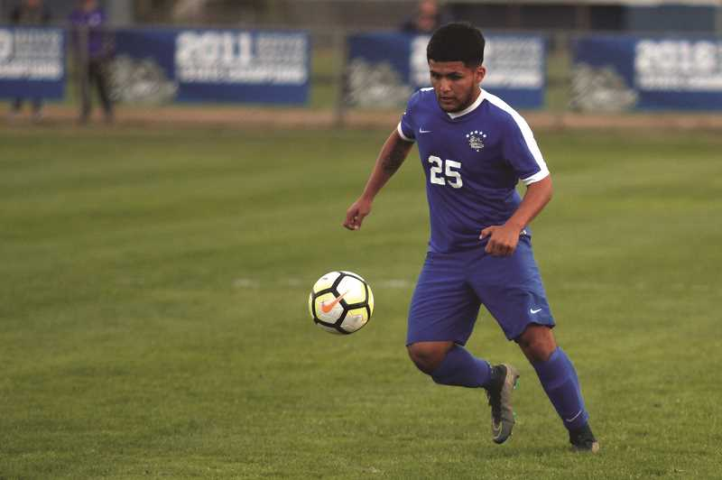 PHIL HAWKINS - Woodburn senior Jesus Rodriguez and the Bulldogs begin their run at a third straight state championship when they host the Mazama Vikings on Tuesday in the first round of the 2018 4A Boys Soccer State Championships.