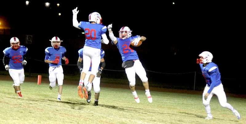 STEELE HAUGEN - Byron Patt, 20, and Victor Torres celebrate after a touchdown.