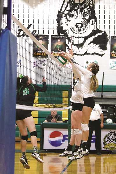 JO WHEAT - North Marion all-conference athletes Katie Ensign and Raymee Boese go up for a block against Sweet Home in the first round of the state playoffs on Saturday.
