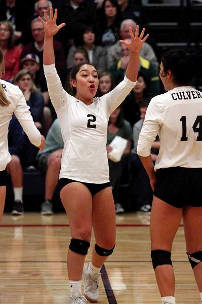 PHIL HAWKINS - Mia Gamboa celebrates after a play against Kennedy. The Lady Dawgs finished with a 24-7 record.