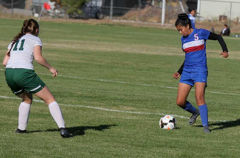 STEELE HAUGEN - Gigi Albarran kicks the ball in this file photo. The Buffs lost 4-1 to Henley during a play-in game Oct. 26.