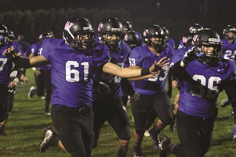 PHIL HAWKINS - The Woodburn football team runs off the field, celebrating its first trip to the state playoff tournament in nearly 50 years after defeating the Tillamook Cheesemakers 18-13 on Friday.