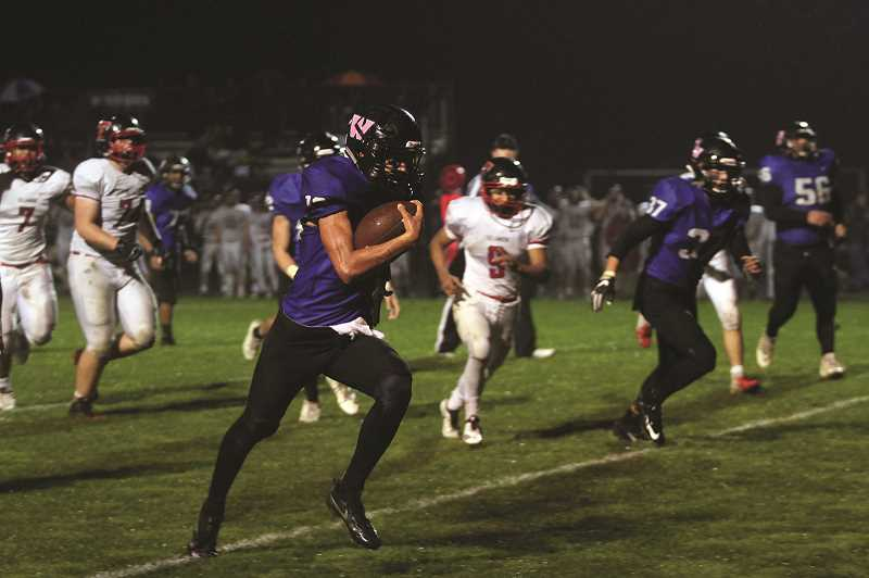 PHIL HAWKINS - Woodburn senior R.J. Veliz scored the game-winning touchdown against the Tillamook Cheesemakers on a 30-yard run with 1:07 remaining in the game.