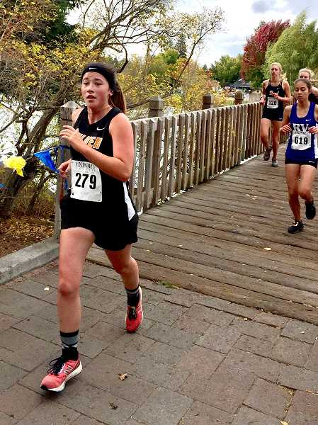 SUBMITTED PHOTO - Kiana Webb was the first Bulldogs to finish the district race, placing 47th.