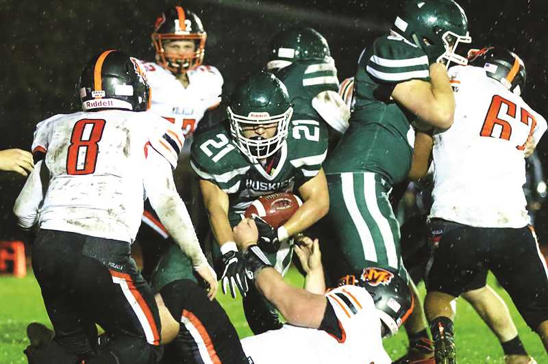 JO WHEAT - North Marion senior Sam Garcia amassed 159 yards and two touchdowns on 31 carries against the Molalla Indians on Friday.
