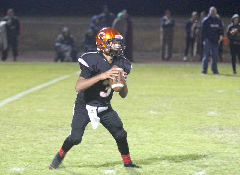 STEELE HAUGEN - Sophmore Anthony Hood drops back for a pass in this file photo.