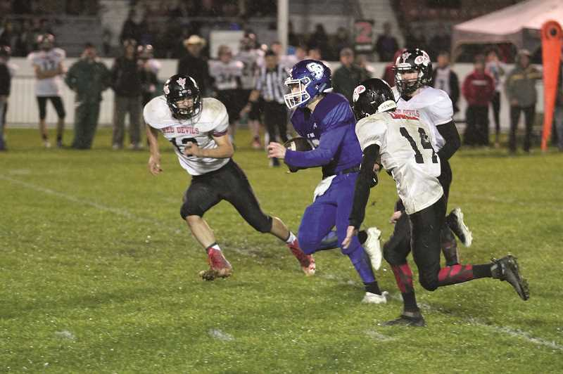 PHIL HAWKINS - St. Paul quarterback T.J. Crawford split three Lowell defenders for a 49-yard touchdown for his first of two scores on the game.