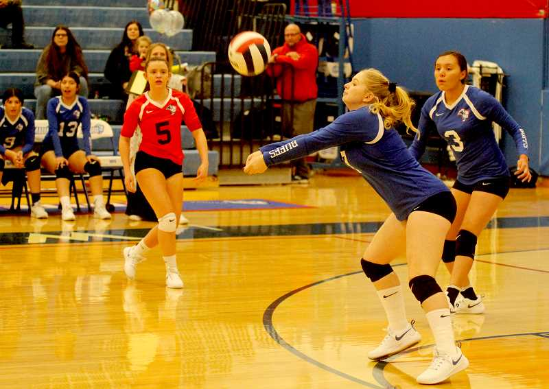 STEELE HAUGEN - Aspen Holcolmb makes a dig during the Buffs last game.