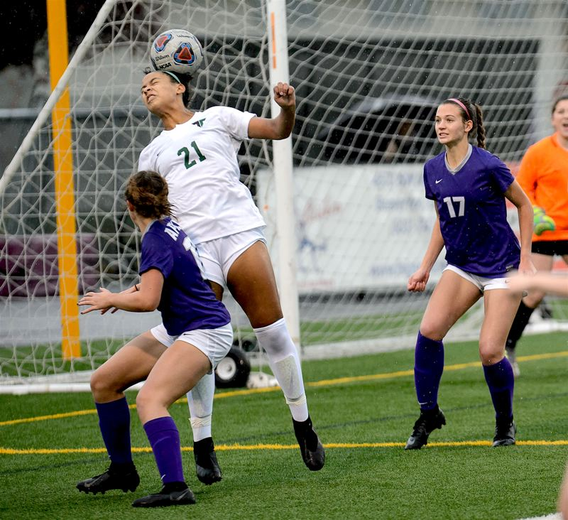COURTESY PHOTO: CHRISTOPHER GERMANO - Tigard senior Gabby Brown (21) scored on a pair of header shots, off of corner kicks, in the Tigers 3-2 state playoff loss at Sunset.