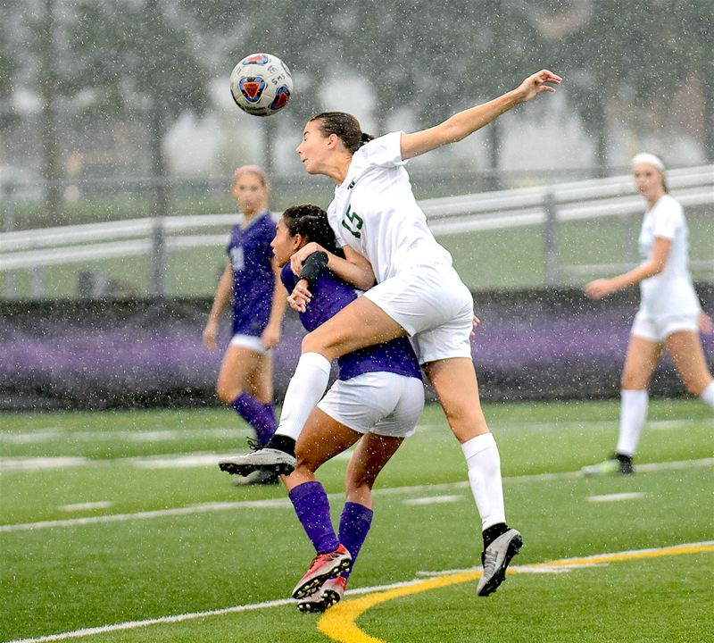COURTESY PHOTO: CHRISTOPHER GERMANO - Tigard High School sophomore Lydia Emory hits a running header during the Tigers state playoff match at Sunset.