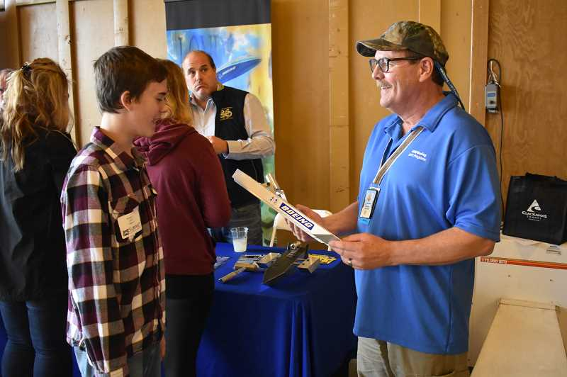 ESTACADA NEWS PHOTO: EMILY LINDSTRAND - A student in Summit Learning Charters Early College program talks with a representative from Boeing during the schools annual Summit at Summit event.