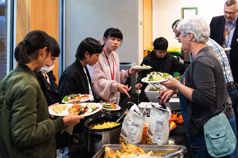 STAFF PHOTO: CHRISTOPHER OERTELL - Dinner was provided to the student delegation, their host families and city and school officials at the Forest Grove Community Auditorium.