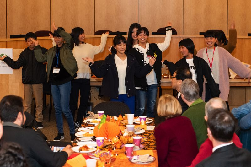 STAFF PHOTO: CHRISTOPHER OERTELL - The 10 students visiting from Nyuzen performed a song and dance during Monday night's welcome dinner reception.