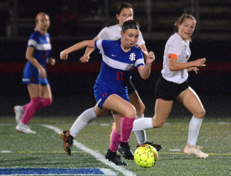 PAMPLIN MEDIA: DAVID BALL - La Salle Preps Maddie Khaw runs onto a through ball in the midfield. She would notch the games first goal early in the second half.