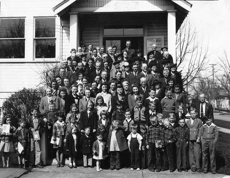 COURTESY PHOTO: HOODVIEW CHURCH OF GOD - This undated photo shows Woodburn's Church of God congregation on the steps of the old building that still sits at Third and Grant streets near downtown Woodburn.