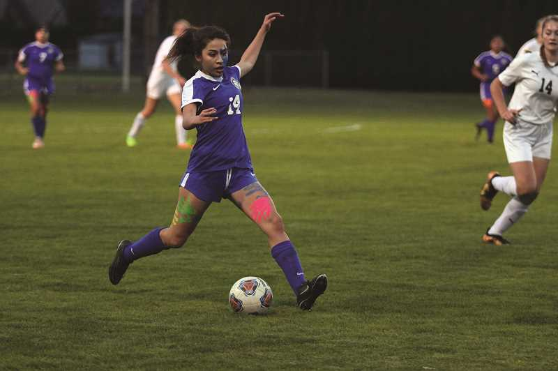 PHIL HAWKINS - Woodburn senior Miriam Nava - pictured on senior night on Oct. 23 - scored a pair of goals in the Bulldogs' 5-0 win over Astoria in the play-in round on Thursday.