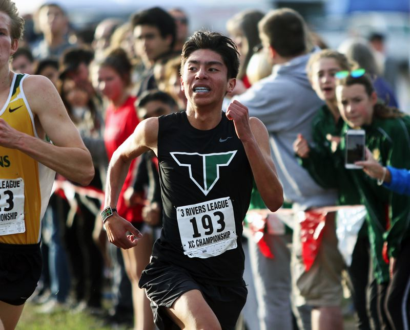 TIMES PHOTO: DAN BROOD - Tigard senior Oscar Nieves Lira sprints to the finish during last weeks Three Rivers League district cross country meet.