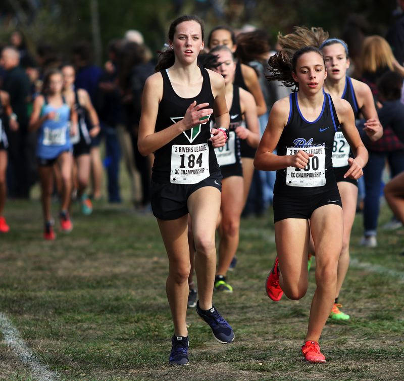 TIMES PHOTO: DAN BROOD - Tigard High School junior Elizabeth Brands finished 20th at the Three Rivers League district cross country meet.