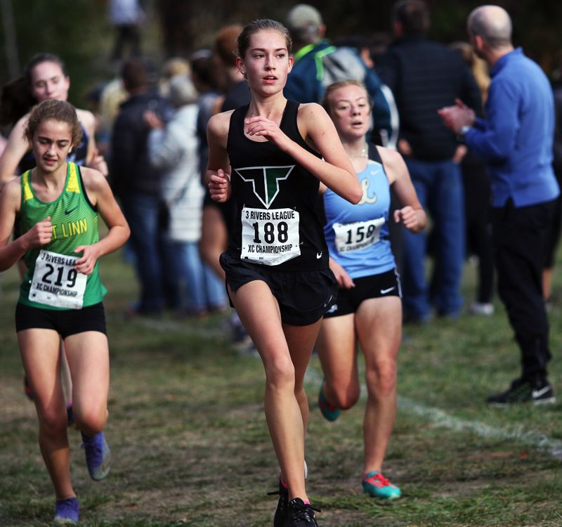 TIMES PHOTO: DAN BROOD - Tigard sophomore Isabelle Ford finished in 21st place at the Three Rivers League district cross country meet.