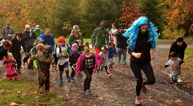 SPOKESMAN PHOTOS: VERN UYETAKE - Runners head out from the start of the Kids Dash Costume Run.