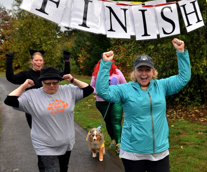 Donna Adkinson, left, and Judy Parker are excited to get started in the 5k race.