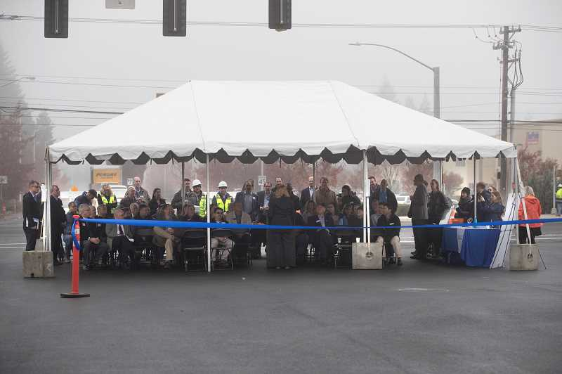 TIMES PHOTO: JAIME VALDEZ - Spectators braved a chilly morning to watch the official dedication of the opening of the 124th Avenue extension.