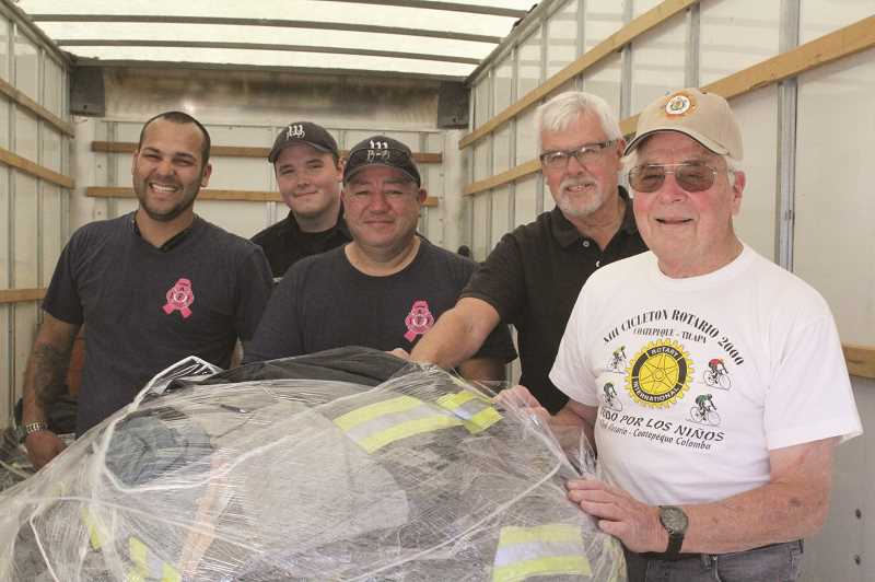LINDSAY KEEFER - Volunteers who loaded a truck Oct. 17 with donated firefighting and medical supplies that went to Mexican volunteer fire departments included (from left) volunteer firefighters Juan Armenta and Keegan Montgomery, FFAO Raul Garza, and East Rotary Club members Erik Larson and Phil Sperl.