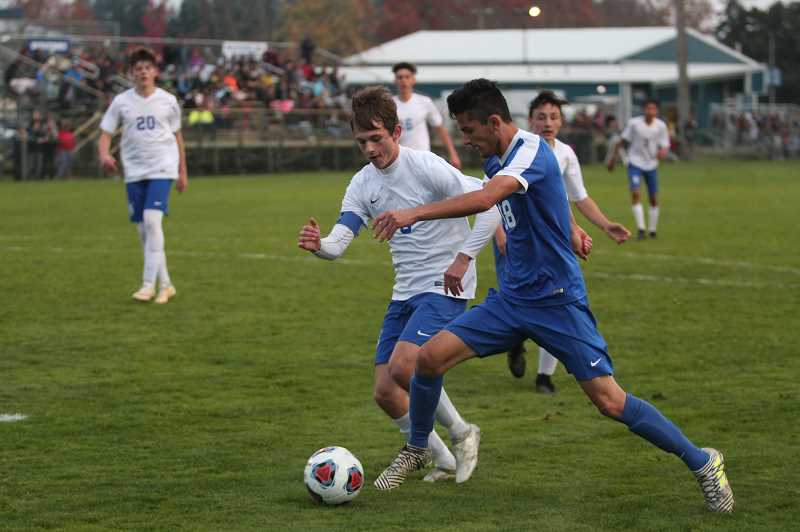 PHIL HAWKINS - Woodburn junior Rodolfo Campuzano scored a pair of second half goals to help lead the Bulldogs to a 3-0 victory over the Mazama Vikings in the first round of the 2018 4A Boys Soccer State Playoffs.