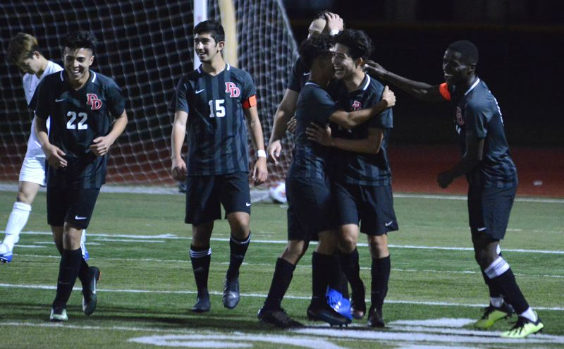 OUTLOOK PHOTO: DAVID BALL - David Douglas celebrates with Rigo Mendez following his second goal in the opening minutes of Tuesdays 4-0 playoff win over Beaverton.
