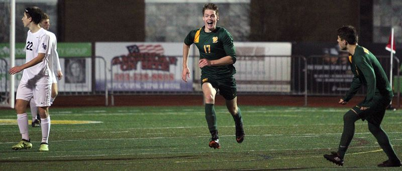 TIDINGS PHOTO: MILES VANCE - West Linn senior defender Garrett Jackson celebrates after scoring the winning goal in overtime to help beat Lake Oswego 4-1 in the second round of the Class 6A state playoffs on Tuesday at West Linn High School.