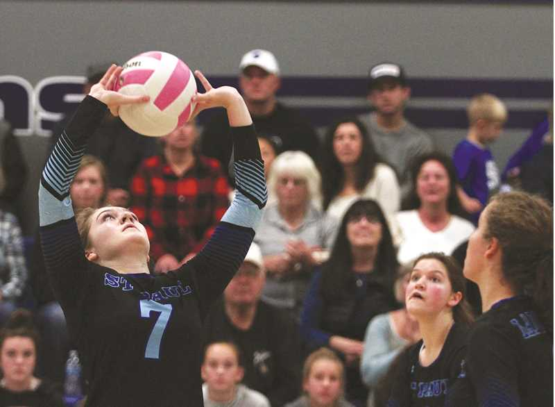 PHIL HAWKINS -- WOODBURN INDEPENDENT - St. Paul sophomore Jordan Caldwell sets up a teammate for the kill in the Bucks' 3-0 win over Crane on Saturday.
