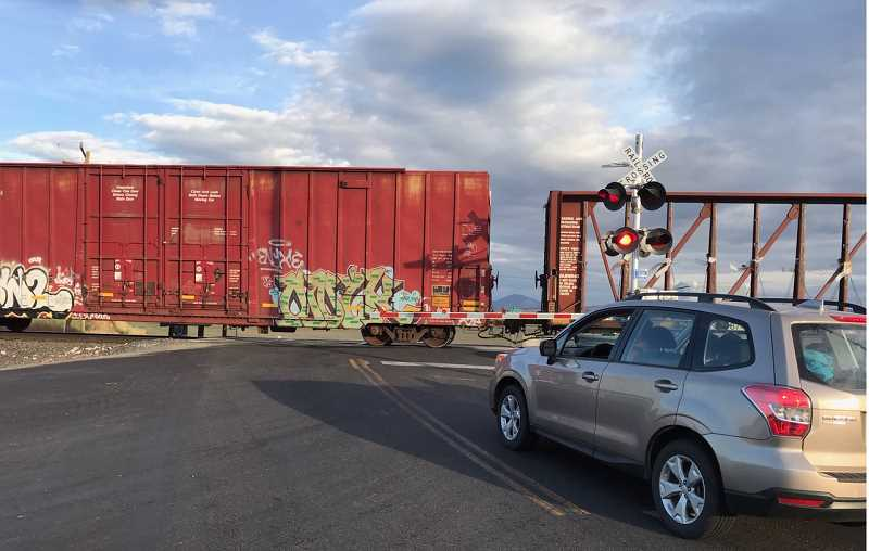 PHOTO BY MARK HAGMAN - The new flashing lights and automatic gates have been installed at the BNSF railroad crossing at Gem Lane and Highway 361, between Culver and Metolius.